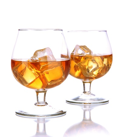 cocktail drinks: Brandy glasses with ice isolated on white