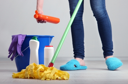 dirty room: Woman cleaning floor in room close-up Stock Photo