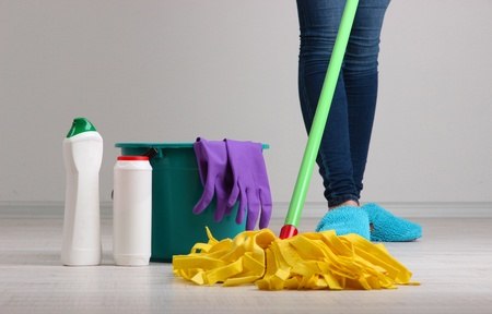 clean house: Woman cleaning floor in room close-up Stock Photo