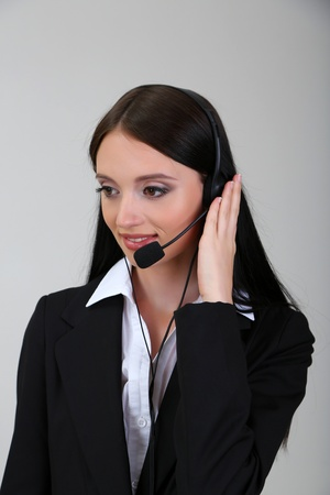 Call center operator, on gray background photo