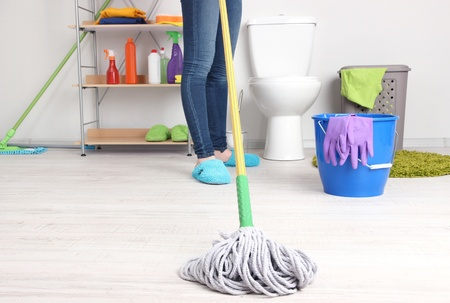 Woman Cleaning floor in room close-up photo