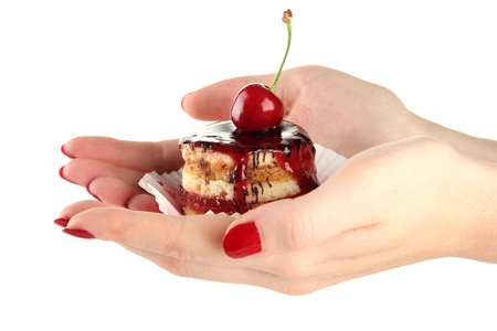 Woman hands holding tasty biscuit cake with jam and berry, isolated on white photo