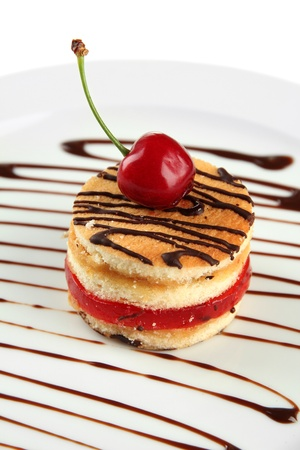 patty cake: Tasty biscuit cake with chocolate and berry on plate