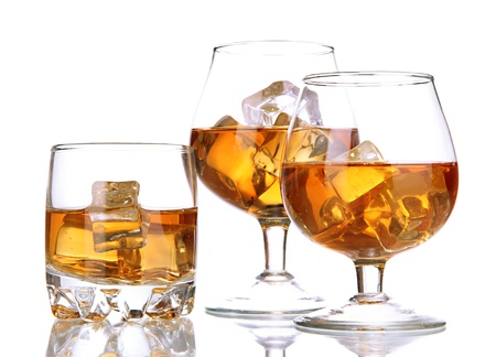 drunks: Brandy glasses with ice isolated on white