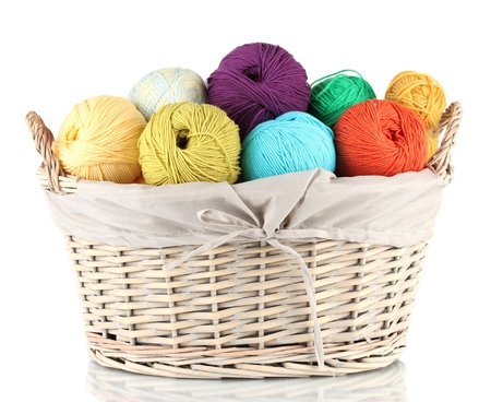 weaved: Colorful yarn balls in wicker basket isolated on white Stock Photo