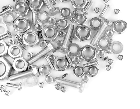 Bolts, screws, nuts isolated on white Фото со стока