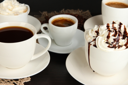 Assortment of different hot coffee drinks close up photo