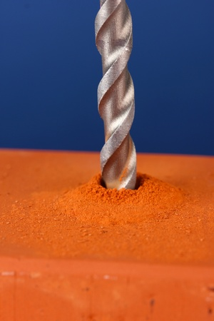 Close-up image of drilling hole on brick, on color background Stock Photo - 20518734