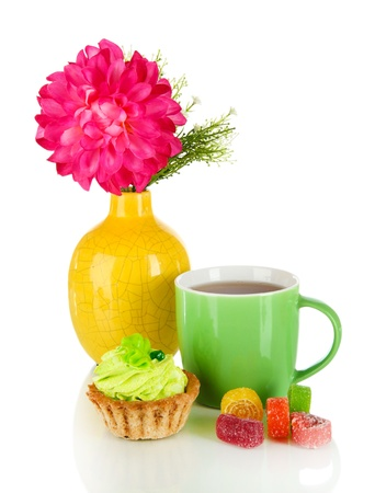 Cup of tea with candy,cake and flower isolated on white photo