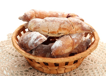 Taste croissants in basket isolated on white Stock Photo - 20587295