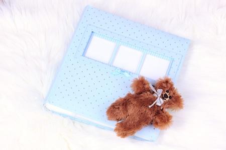 Baby photo album on white carpet photo