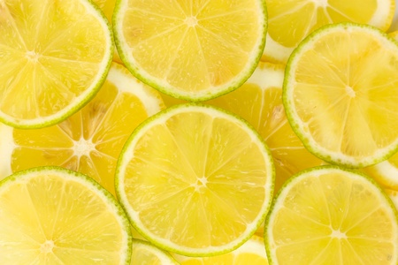 Lime and lemon slices background photo