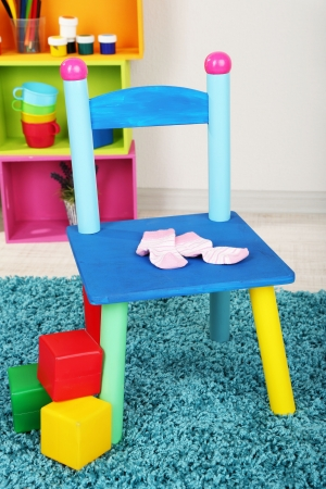 Small and colorful chair for little kids photo