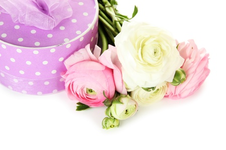 Ranunculus (persian buttercups) and gift, isolated on white photo