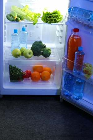 Open refrigerator with vegetarian food Stock Photo - 20647448