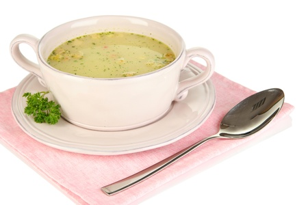 Nourishing soup with vegetables in pan isolated on white photo