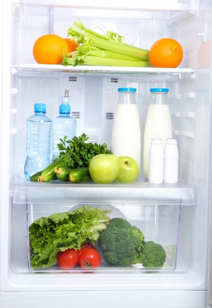 Open refrigerator with vegetarian food Stock Photo - 20653085