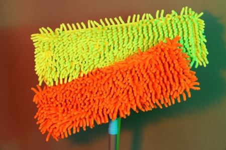 office cleanup: Two mops for floor on bright background