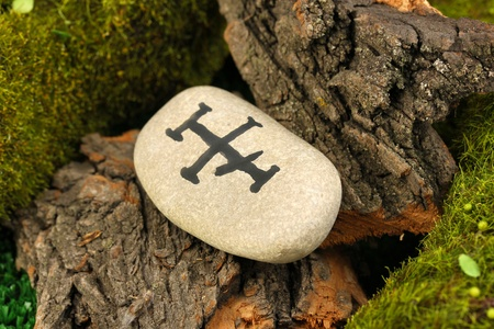 Fortune telling  with symbols on stone close up Stock Photo - 20653253