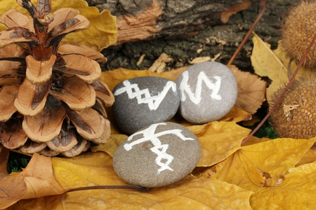 Fortune telling  with symbols on stones close up Stock Photo - 20653216