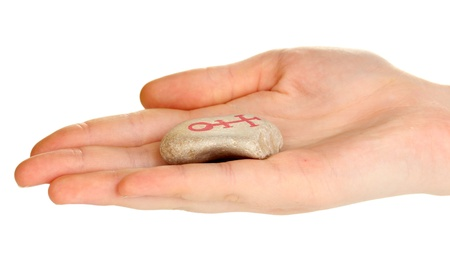 Fortune telling  with symbols on stone in hand isolated on white Stock Photo - 20652266