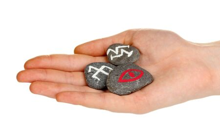 rune: Fortune telling  with symbols on stone in hand isolated on white