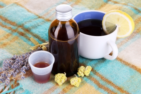 Cough syrup on knitted scarf close-up Stock Photo - 20653185