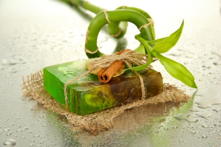 Hand-made soap and bamboo with drops, close up photo