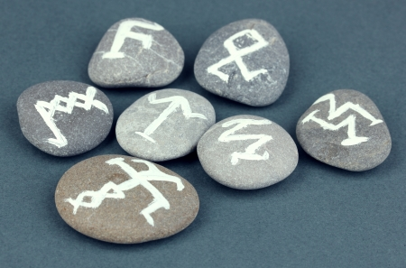 Fortune telling  with symbols on stones on grey background Stock Photo - 20652390