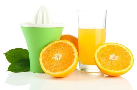 Citrus press, glass of juice and ripe oranges, isolated on white photo