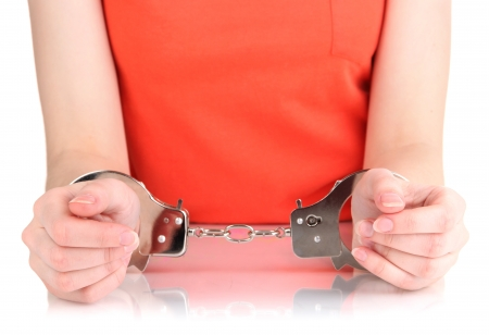 Prisoner in handcuffs isolated on white Stock Photo - 20652527