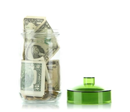 Glass jar with money isolated on white photo