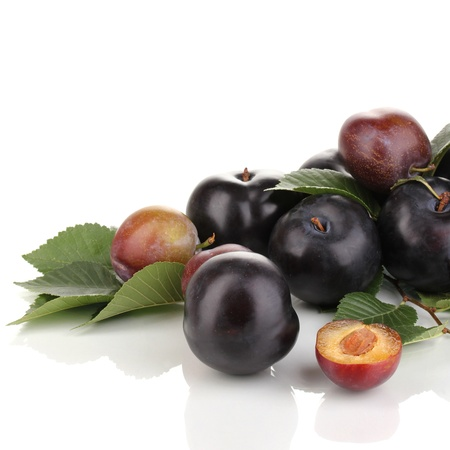 Rip plums isolated on white photo