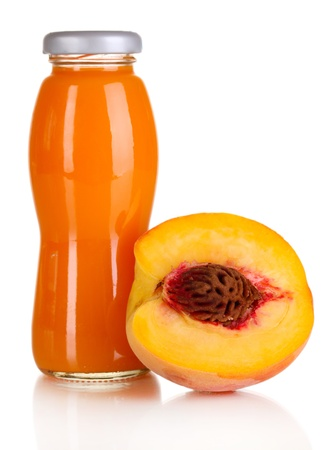 Delicious peach juice in glass bottle and peach next to it isolated on white photo