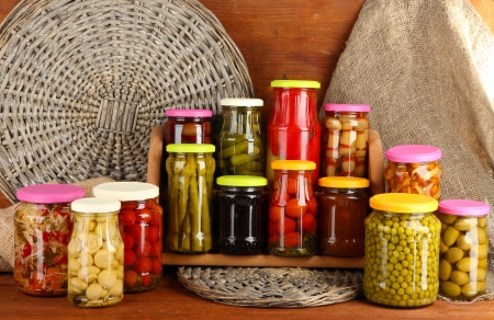 canned food: Different conservations on shelves on wooden background