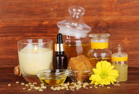humidify: Fragrant honey spa with oils and honey on wooden table on wooden background Stock Photo