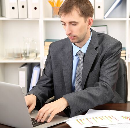 careerists: Young businessman in office at his workplace