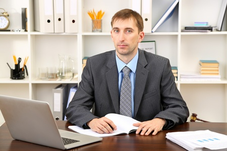 Young businessman in office at his workplace Stock Photo - 21526526