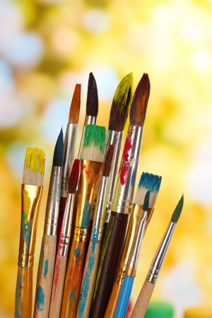 Many brush in paint on nature background photo