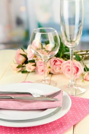 Table serving on a wooden background on the background of the room photo