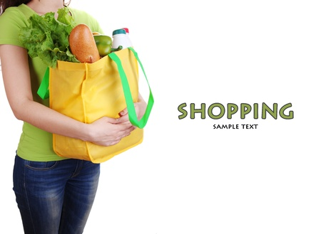 pone: Girl with shopping bag isolated on white Stock Photo