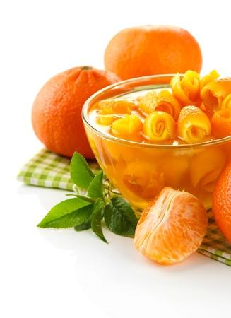 zest: Orange jam with zest and tangerines, isolated on white