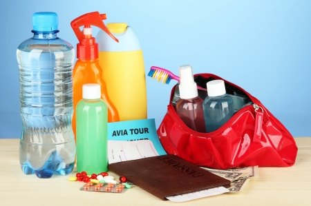 Travelling items on color background photo