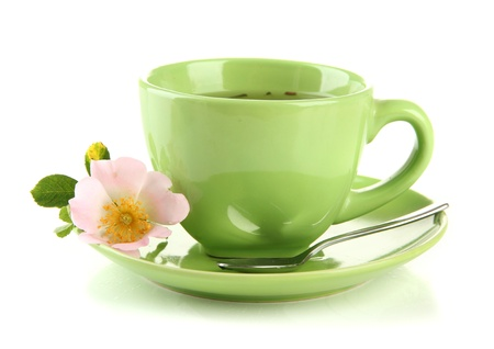 Cup of herbal tea with hip rose flower, isolated on white photo
