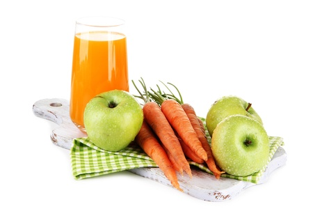 Glass of juice, apples and carrots, isolated on white photo