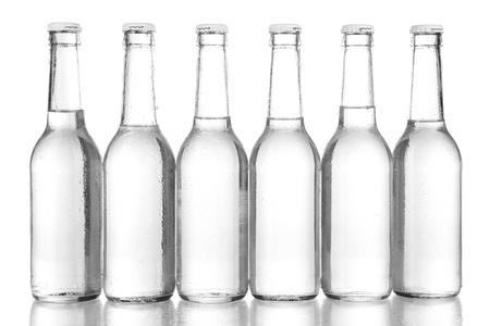 bottleneck: Water bottles isolated on white Stock Photo