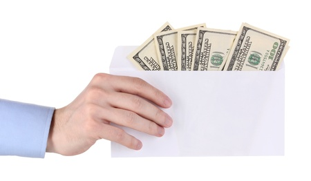 mans hand holding an envelope with dollars on white background photo
