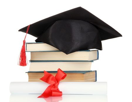 alumna: Grad hat with diploma and books isolated on white