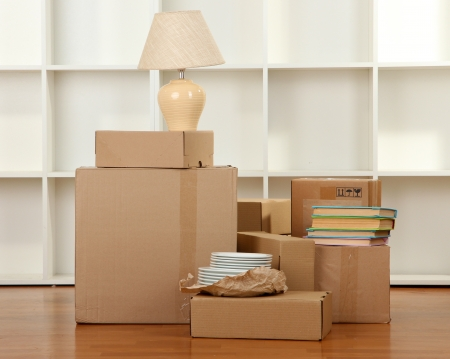 moving house: Moving boxes in empty room Stock Photo