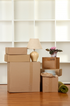 removals: Moving boxes in empty room Stock Photo